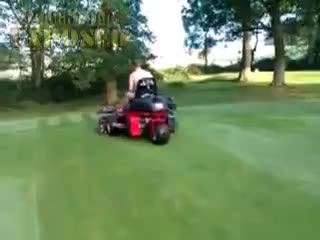 Naked greenkeeper cutting greens