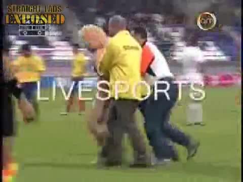 A naked man run during a soccer match