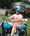 Big J Merlin naked on is bike