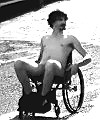 Naked man ridin in a wheelchair