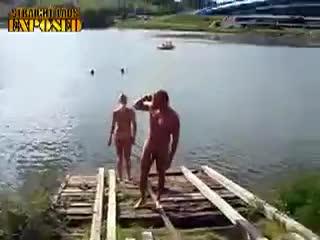 Nude man takes a swim