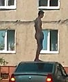naked russian man on car