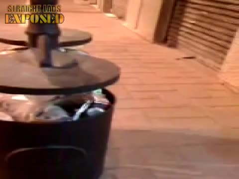 lad pisses in rubbish bin