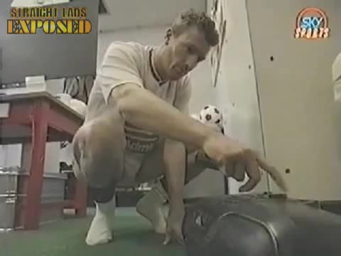 footballer bending down