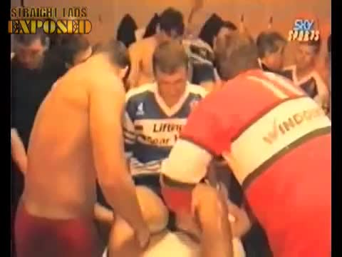 footballer gets massage from team mate