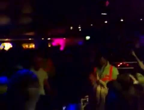 lad in night club strips