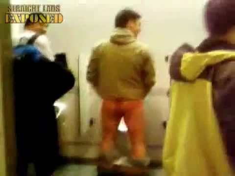lad pisses at urinals