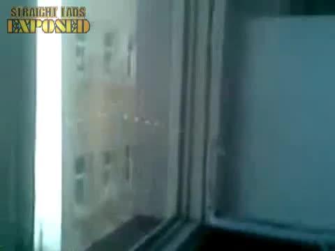 lad pissing on window