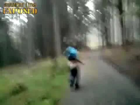 lad pulls down pants
