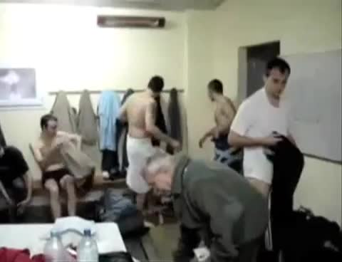 footballers singing in locker room