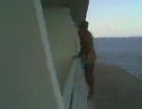 naked lad climbs balcony