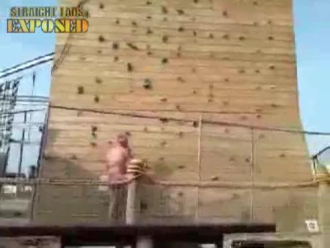 naked lad climbs wall
