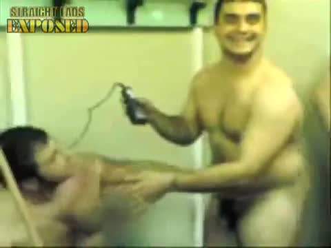 naked rugby player shaves teammates head