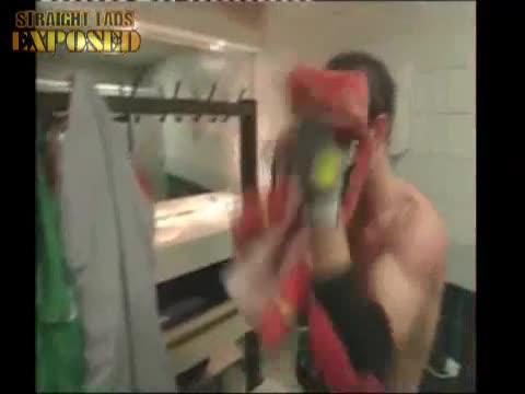 lad towels off in locker room