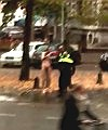 A Naked Man Walks On Street