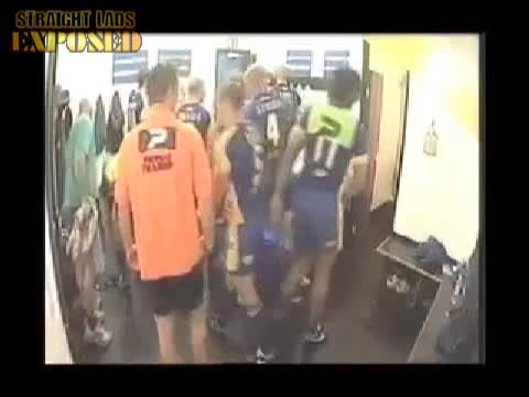 rugby player takes piss in locker room