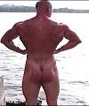 Naked Muscle Man At Lake