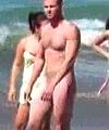 Naked Man Walks On Beach