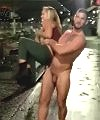 Woman Carried By Naked Man