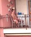 Naked Man On The Balcony