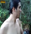 naked lad in a waterfall