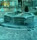 naked man in a fountain