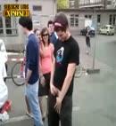 lad pisses street