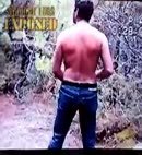 man strips in a forest